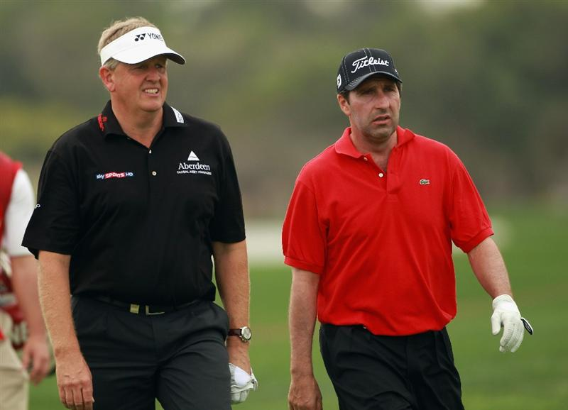 ABU DHABI, UNITED ARAB EMIRATES - JANUARY 20:  Colin Montgomerie of Scotland (left) and Jose Maria Olazabal of Spain walk together on the ninth hole during the first round of The Abu Dhabi HSBC Golf Championship at Abu Dhabi Golf Club on January 20, 2011 in Abu Dhabi, United Arab Emirates.  (Photo by Andrew Redington/Getty Images)
