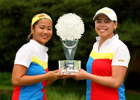 SUN CITY, SOUTH AFRICA - JANUARY 20:  Jennifer Rosales and Dorothy Delasin of The Philippines celebrate victory with the trophy after the final round of the Women's World Cup of Golf at The Gary Player Country Club on January 20, 2008 in Sun City, South Africa.  (Photo by Richard Heathcote/Getty Images)