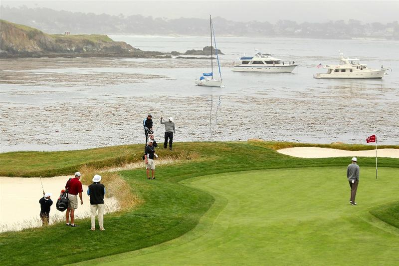 PEBBLE BEACH, CA - JUNE 14:  Tiger Woods plays a bunker shot on the 17th hole during a practice round prior to the start of the 110th U.S. Open at Pebble Beach Golf Links on June 14, 2010 in Pebble Beach, California.  (Photo by Ross Kinnaird/Getty Images)