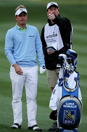 MARANA, AZ - FEBRUARY 26:  Luke Donald of England (L) talks with his caddie John McLaren (R) before playing an approach shot on the second hole during the quarterfinal round of the Accenture Match Play Championship at the Ritz-Carlton Golf Club on February 26, 2011 in Marana, Arizona.  (Photo by Andy Lyons/Getty Images)