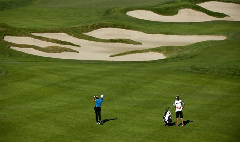 SAN MARTIN, CA - OCTOBER 15:  Will MacKenzie (L) makes an approach shot on the eight hole during the second round of the Frys.com Open at the CordeValle Golf Club on October 15, 2010 in San Martin, California.  (Photo by Robert Laberge/Getty Images)