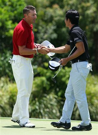 SUNSHINE COAST, AUSTRALIA - DECEMBER 10: Robert Allenby of Australia and Wenchong Liang of China shake hands after completing their rounds  during day two of the 2010 Australian PGA Championship at the Hyatt Regency Coolum on December 10, 2010 at the Sunshine Coast, Australia.  (Photo by Bradley Kanaris/Getty Images)