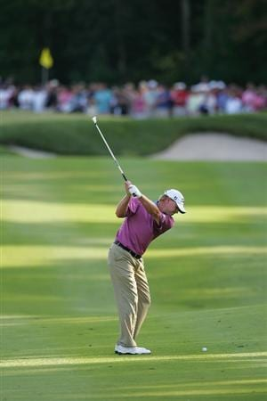 NORTON, MA - SEPTEMBER 07:  Steve Stricker hits his second shot on the 14th hole during the final round of the Deutsche Bank Championship at TPC Boston held on September 7, 2009 in Norton, Massachusetts.  (Photo by Michael Cohen/Getty Images)