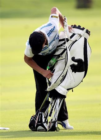 KUALA LUMPUR, MALAYSIA - MARCH 04:  Joost Luiten of the Netherlands looking for a ball in his golf bag  during the first round of the Maybank Malaysia Open at the Kuala Lumpur Golf & Country on March 4, 2010 in Kuala Lumpur, Malaysia.  (Photo by Ross Kinnaird/Getty Images)
