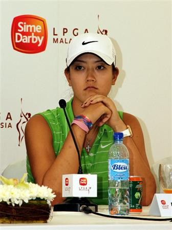 KUALA LUMPUR, MALAYSIA - OCTOBER 20 :  Michelle Wie of USA in deep thoughts during the Sime Darby LPGA press conference on October 20, 2010 held at the Sime Darby Convention Centre in Kuala Lumpur, Malaysia.  (Photo by Stanley Chou/Getty Images)