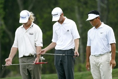(L-R) Charley Hoffman and Sean O'Hair help K.J. Choi with a ball placement in the rough just off the seventh green during the first round of the 2007 Shell Houston Open Thursday, March 29, 2007, on the Tournament Course at the Redstone Golf Club in Humble, Texas. PGA Tour - 2007 Shell Houston Open - First RoundPhoto by Kevin C.  Cox/WireImage.com