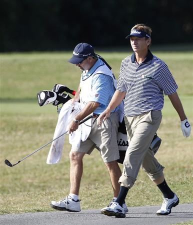 RIO GRANDE, PR - MARCH 10: Brad Faxon walks with his pants rolled up after hitting a shot from the rough during the first round of the Puerto Rico Open presented by seepuertorico.com at Trump International Golf Club on March 10, 2011 in Rio Grande, Puerto Rico.  (Photo by Michael Cohen/Getty Images)