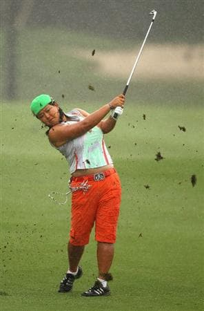 GOLD COAST, AUSTRALIA - MARCH 05:  Christina Kim of the USA plays an approach shot in the rain on the 8th hole during round two of the 2010 ANZ Ladies Masters at Royal Pines Resort on March 5, 2010 in Gold Coast, Australia.  (Photo by Ryan Pierse/Getty Images)