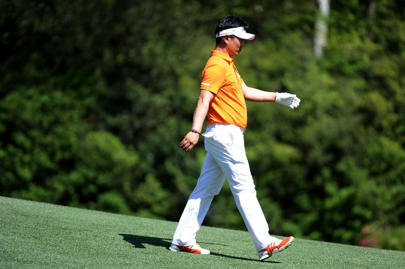 AUGUSTA, GA - APRIL 07:  Y.E. Yang of South Korea walks off the 12th tee during the first round of the 2011 Masters Tournament at Augusta National Golf Club on April 7, 2011 in Augusta, Georgia.  (Photo by Harry How/Getty Images)