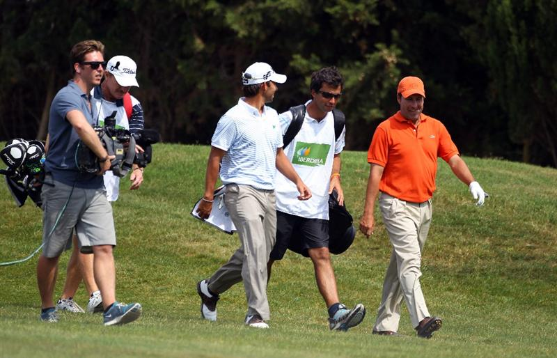 MALLORCA, SPAIN - MAY 12:  Jose Maria Olazabal of Spain walks down the fairway with Pablo Larrazabal of Spain during day one of the Iberdrola Open at Pula Golf Club on May 12, 2011 in Mallorca, Spain.  (Photo by Julian Finney/Getty Images)