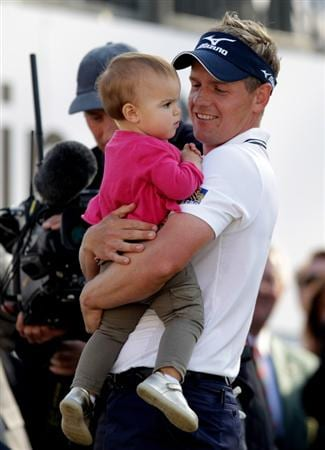 VIRGINIA WATER, ENGLAND - MAY 29:  Luke Donald of England holds his daughter Elle following his victory in a playoff on the 18th green during the final round of the BMW PGA Championship  at the Wentworth Club on May 29, 2011 in Virginia Water, England.  (Photo by Ross Kinnaird/Getty Images)