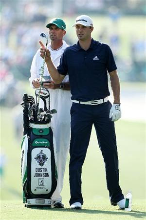 AUGUSTA, GA - APRIL 08:  Dustin Johnson pulls a club alongside his caddie Robert Brown during the first round of the 2010 Masters Tournament at Augusta National Golf Club on April 8, 2010 in Augusta, Georgia.  (Photo by Andrew Redington/Getty Images)