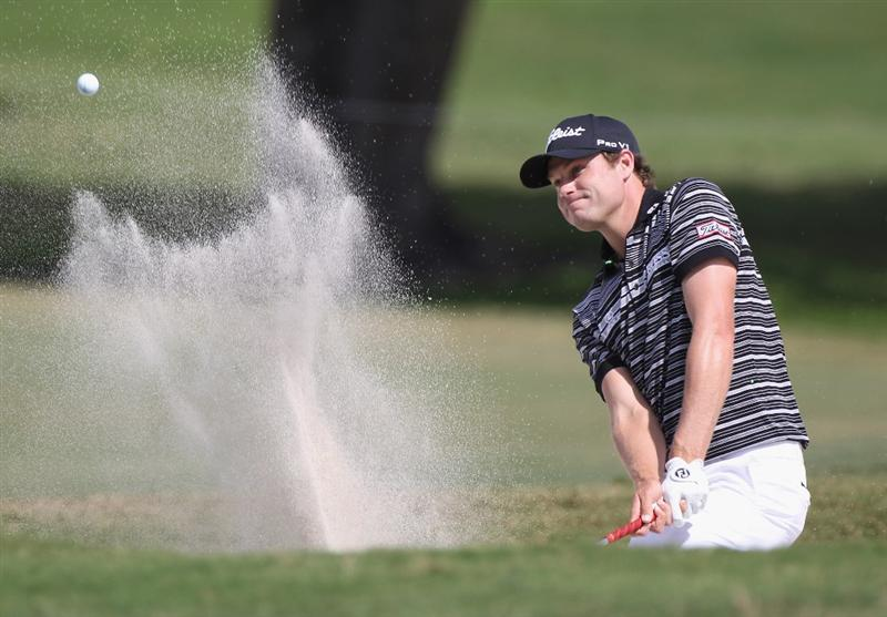 DORAL, FL - MARCH 12:  Nick Watney hits a bunker  shot on the fourth hole during the third round of the 2011 WGC- Cadillac Championship at the TPC Blue Monster at the Doral Golf Resort and Spa on March 12, 2011 in Doral, Florida.  (Photo by Sam Greenwood/Getty Images)