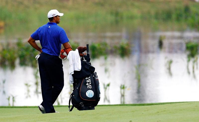 JERSEY CITY, NJ - AUGUST 29:  Tiger Woods waits to play his second shot in the 13th fairway during round three of The Barclays on August 29, 2009 at Liberty National in Jersey City, New Jersey.  (Photo by Kevin C. Cox/Getty Images)