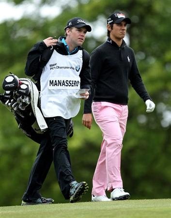 VIRGINIA WATER, ENGLAND - MAY 28:  Matteo Manassero of Italy and caddie Ryan McGuigan walk up the 1st hole during the third round of the BMW PGA Championship at the Wentworth Club on May 28, 2011 in Virginia Water, England.  (Photo by Ian Walton/Getty Images)
