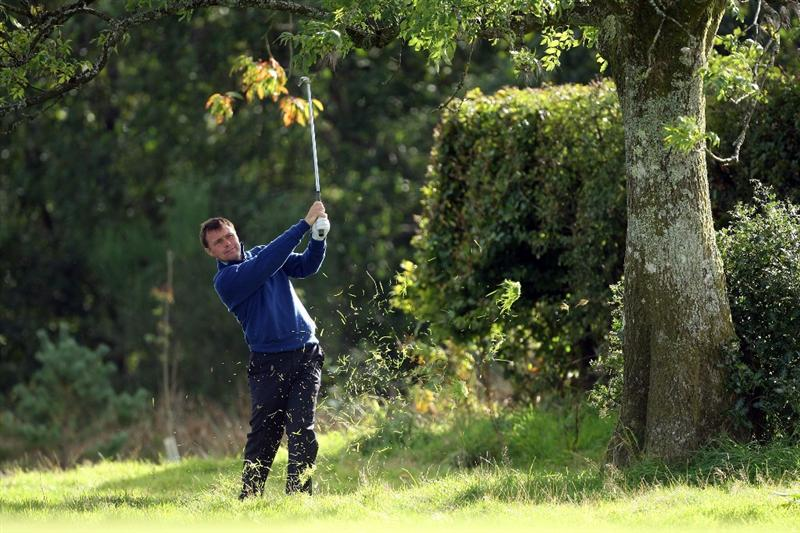 DUMBARTON, SCOTLAND - SEPTEMBER 18:  Paul Simpson of England and the Great Britain and Ireland Team in action at the 9th hole during the afternoon fourball matches at The Carrick on Loch Lomond on September 19, 2009 in Dumbarton, Scotland.  (Photo by David Cannon/Getty Images)