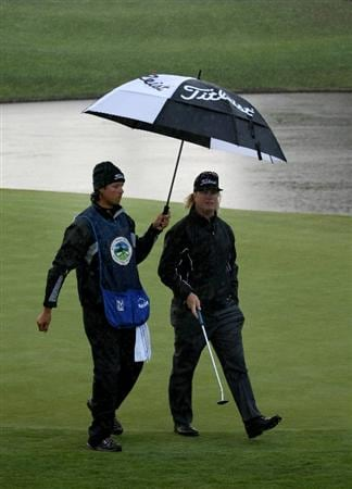 PEBBLE BEACH, CA - FEBRUARY 13: Charley Hoffman walks on the green with his caddy holding an umnbrella over him on the 11th hole at Poppy Hills Golf Course during the second round of the the AT&T Pebble Beach National Pro-Am on February 13, 2009 in Pebble Beach, California. (Photo by Stephen Dunn/Getty Images)