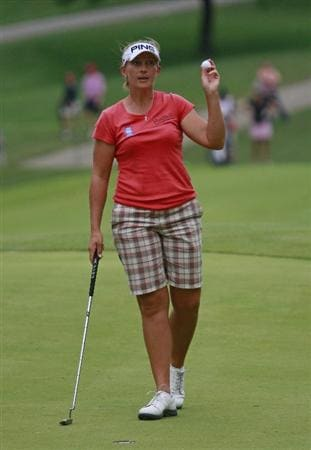 ROGERS, AR - SEPTEMBER 12:  Angela Stanford waves after making a birdie on the 18th hole to take the lead in the second round play in the P&G Beauty NW Arkansas Championship at the Pinnacle Country Club on September 12, 2009 in Rogers, Arkansas.  (Photo by Dave Martin/Getty Images)