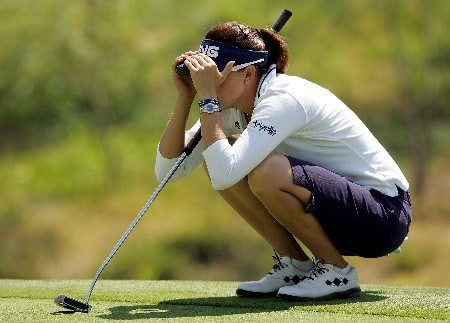 MORELIA, MEXICO - APRIL 26:  Stacy Prammanasudh of the United States lines up a putt on the third green during the first round of the Corona Championship April 26, 2007 at Tres Marias Club de Golf in Morelia, Michoacan, Mexico.  (Photo by Matthew Stockman/Getty Images)