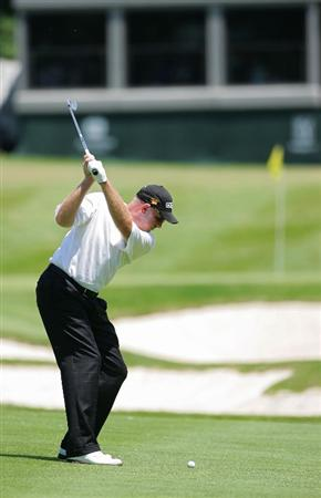 SILVIS, IL - JULY 11:  Frank Lickliter III plays a shot from the fairway during the continuation of the second round of the John Deere Classic at TPC Deere Run held on July 11, 2009 in Silvis, Illinois.  (Photo by Michael Cohen/Getty Images)