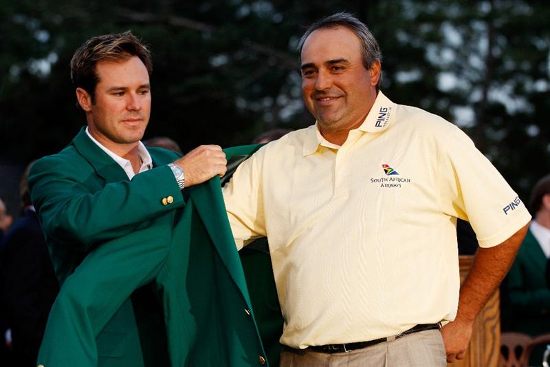 AUGUSTA, GA - APRIL 12:  Trevor Immelman of South Africa presents Angel Cabrera of Argentina with the green jacket during the green jacket presentation after Cabrera defeated Kenny Perry on the second sudden death playoff hole to win the 2009 Masters Tournament at Augusta National Golf Club on April 12, 2009 in Augusta, Georgia.  (Photo by Jamie Squire/Getty Images)
