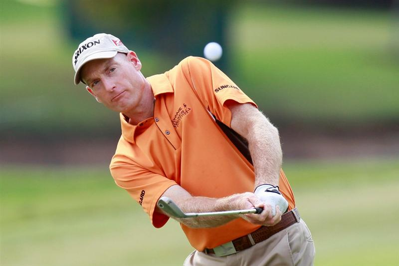 ATLANTA - SEPTEMBER 24:  Jim Furyk hits a chip shot on the ninth hole during the second round of THE TOUR Championship presented by Coca-Cola at East Lake Golf Club on September 24, 2010 in Atlanta, Georgia.  (Photo by Kevin C. Cox/Getty Images)