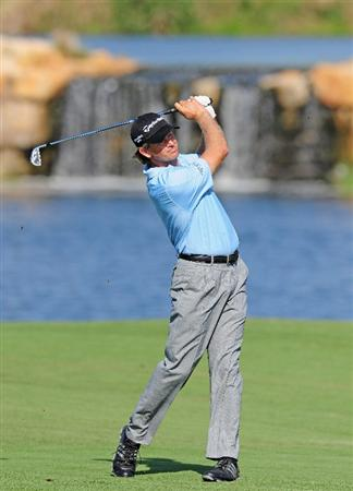 VILAMOURA, PORTUGAL - OCTOBER 17:  Retief Goosen of South Africa plays his approach shot on the seventh hole during the third round of the Portugal Masters at the Oceanico Victoria Golf Course on October 17, 2009 in Vilamoura, Portugal.  (Photo by Stuart Franklin/Getty Images)