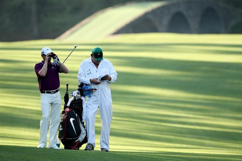AUGUSTA, GA - APRIL 06:  Simon Dyson of England looks on with his caddie during a practice round prior to the 2010 Masters Tournament at Augusta National Golf Club on April 6, 2010 in Augusta, Georgia.  (Photo by Andrew Redington/Getty Images)