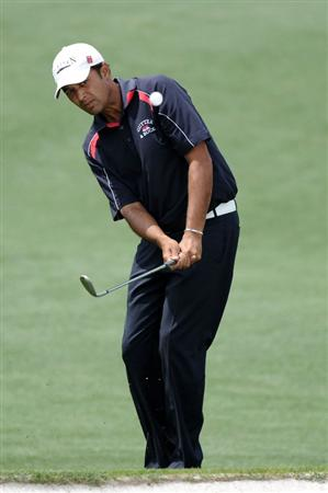 AUGUSTA, GA - APRIL 08:  Arjun Atwal of India pitches to the second green during the second round of the 2011 Masters Tournament at Augusta National Golf Club on April 8, 2011 in Augusta, Georgia.  (Photo by Harry How/Getty Images)