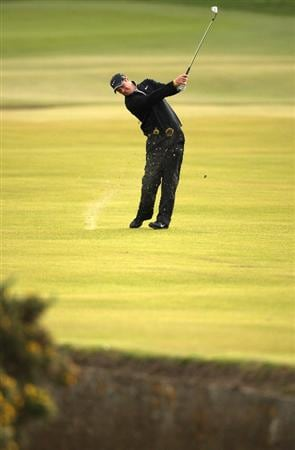 ST ANDREWS, SCOTLAND - OCTOBER 05:  Marc Warren of Scotland plays his second shot to the first green during the final round of The Alfred Dunhill Links Championship at The Old Course on October 5, 2009 in St.Andrews, Scotland. (Photo by Warren Little/Getty Images)