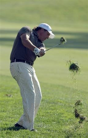 LA JOLLA, CA - JANUARY 29:  Phil Mickelson hits out of the rough on the 18th hole during Round 3 of the Farmers Insurance Open at Torrey Pines on January 29, 2011 in La Jolla, California. (Photo by Donald Miralle/Getty Images)