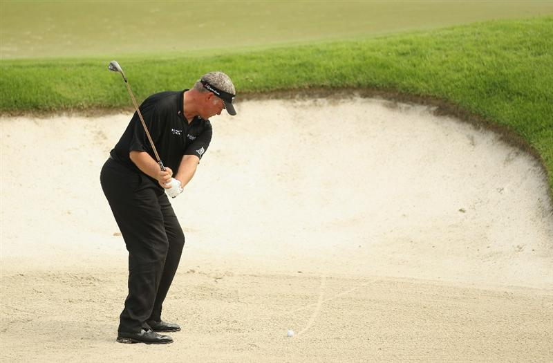 SINGAPORE - NOVEMBER 10:  Darren Clarke of Northern Ireland in action during the Pro-Am of the Barclays Singapore Open at Sentosa Golf Club on November 10, 2010 in Singapore, Singapore.  (Photo by Ian Walton/Getty Images)