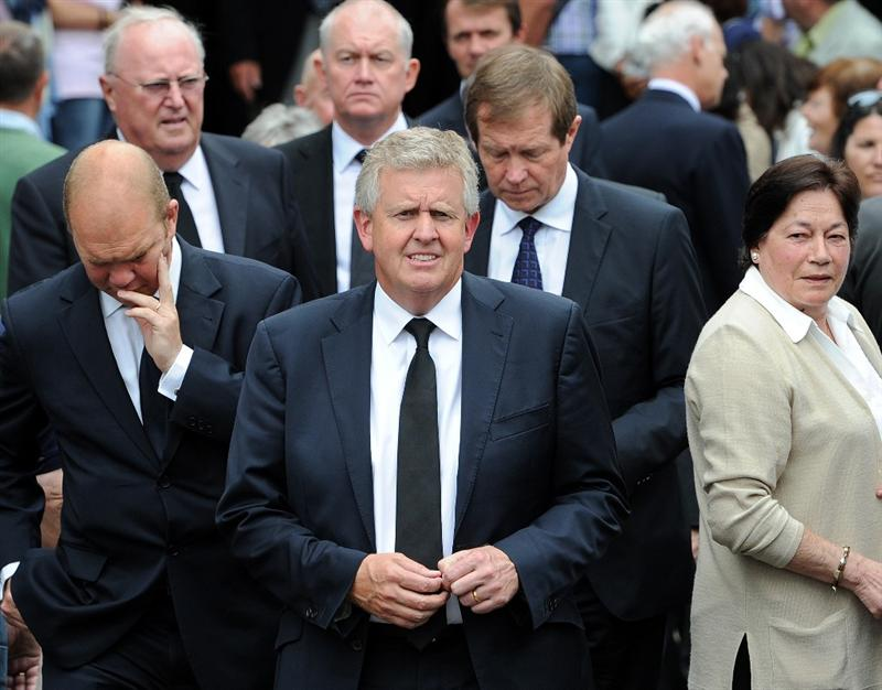 PEDRENA, SPAIN - MAY 11:  Golfer Colin Montgomerie (C) of Scotland leaves the funeral service held for legendary Spanish golfer Seve Ballesteros on May 11, 2011 in Pedrena, Spain. Top-ranked golf players have joined family members and friends to pay their last respects to the late golf great, who died on May 7, 2011 from complications arising from a brain tumor, in his home town parish church.  (Photo by Jasper Juinen/Getty Images)