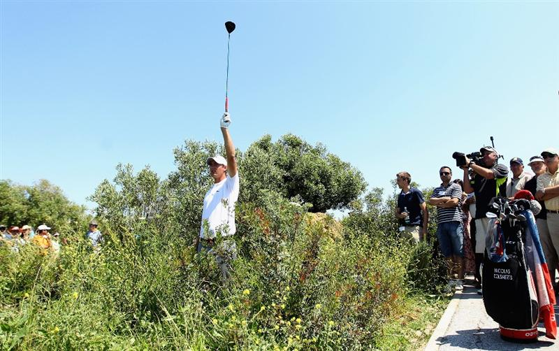 CASARES, SPAIN - MAY 22:  Nicolas Colsaerts of Belgium holds up his club in the rough on the 16th hole during the semi final of the Volvo World Match Play Championship at Finca Cortesin on May 22, 2011 in Casares, Spain.  (Photo by Warren Little/Getty Images)