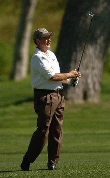 Larry Nelson hits an approach shot on the 4th hole during the first round of the Champions' Tour 2005 SBC Classic at the Valencia Country Club in Valencia, California March 11, 2005.
