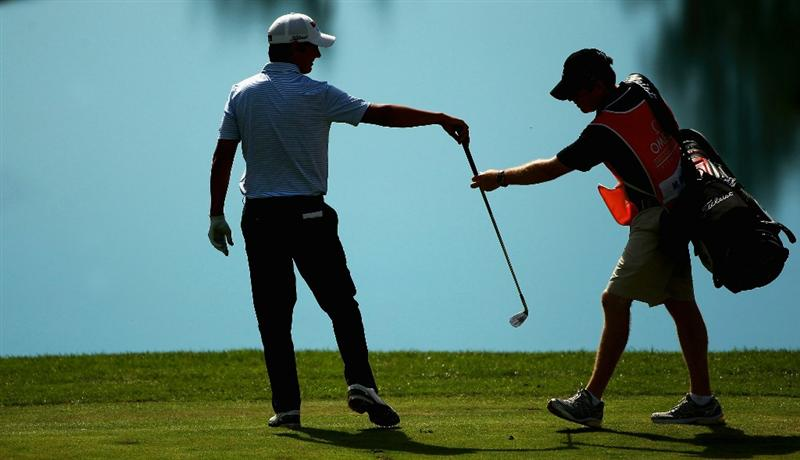 CRANS, SWITZERLAND - SEPTEMBER 04:  Matteo Manassero of Italy hands his club back to his caddie during the third round of The Omega European Masters at Crans-Sur-Sierre Golf Club on September 4, 2010 in Crans Montana, Switzerland.  (Photo by Warren Little/Getty Images)