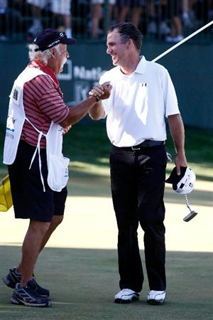 BOISE, ID - SEPTEMBER 20:  Fran Quinn is congratulated by his caddie after winning  the Albertson's Boise Open at Hillcrest Country Club on September 20, 2009 in Boise, Idaho.  (Photo by Jonathan Ferrey/Getty Images)