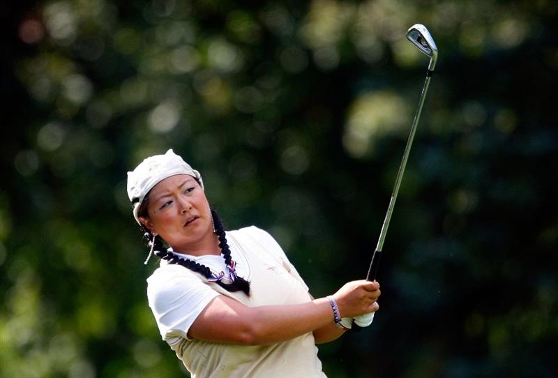 SUGAR GROVE, IL - AUGUST 20:  Christina Kim of the U.S. Team watches a shot during a practice round prior to the start of the 2009 Solheim Cup at Rich Harvest Farms on August 20, 2009 in Sugar Grove, Illinois.  (Photo by Scott Halleran/Getty Images)