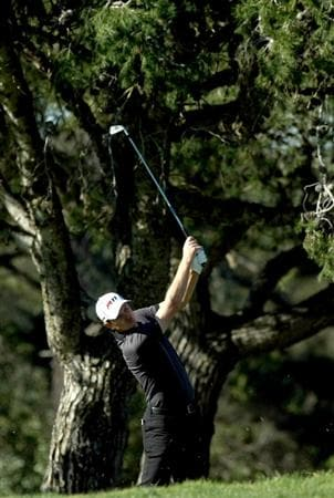 LA JOLLA, CA - JANUARY 28:  Justin Rose of England hits off the 13th fairway rough during the second round of the Farmers Insurance Open at Torrey Pines on January 28, 2011 in La Jolla, California. (Photo by Donald Miralle/Getty Images)