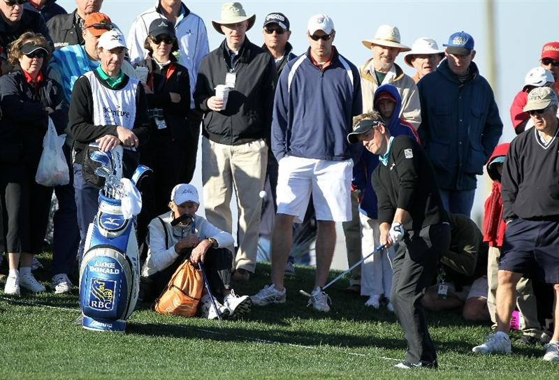 MARANA, AZ - FEBRUARY 23:  Luke Donald of England plays his third shot on the second hole as a gallery of fans looks on during the first round of the Accenture Match Play Championship at the Ritz-Carlton Golf Club on February 23, 2011 in Marana, Arizona.  (Photo by Andy Lyons/Getty Images)