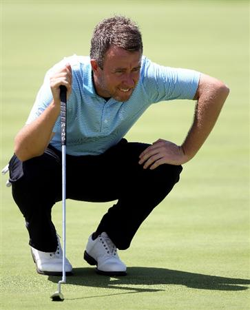 SEVILLE, SPAIN - APRIL 29:  Mark Foster of England on the par four 18th hole during the first round of the Open de Espana at the Real Club de Golf de Seville on April 29, 2010 in Seville, Spain.  (Photo by Ross Kinnaird/Getty Images)