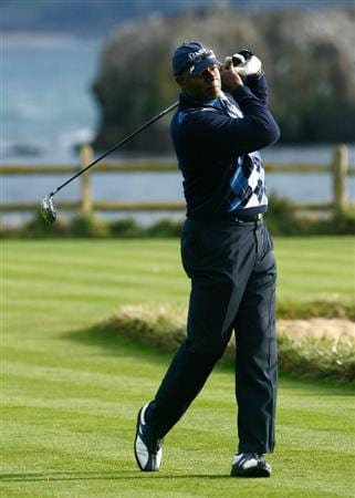 PEBBLE BEACH, CA - FEBRUARY 14: Dennis Haysbert hits a tee shot on the 18th hole during the third round of the AT&T Pebble Beach National Pro-Am at the Pebble Beach Golf Links on February 14, 2009 in Pebble Beach, California. (Photo by Jeff Gross/Getty Images)