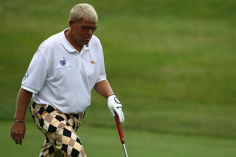 OAKVILLE, ONTARIO, CANADA - JULY 25: John Daly walks onto the ninth hole to finish his round during round two of the RBC Canadian Open at Glen Abbey Golf Club on July 25, 2009 in Oakville, Ontario, Canada.  (Photo by Chris McGrath/Getty Images)