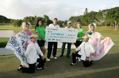 Scott Dunlap (C) holds the winner's check with National Dancers of Panama following the fourth round of the Movistar Panama Championship at Club de Golf de Panama January 27, 2008 in Panama City, Panama. Nationwide Tour - 2008 Movistar Panama Championship - Final RoundPhoto by Stan Badz/PGA TOUR/Getty Images