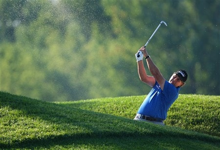 BLOOMFIELD HILLS, MI - AUGUST 07:  Phil Mickelson plays a shot from a bunker on the 11th hole during round one of the 90th PGA Championship at Oakland Hills Country Club on August 7, 2008 in Bloomfield Township, Michigan.  (Photo by Stuart Franklin/Getty Images)