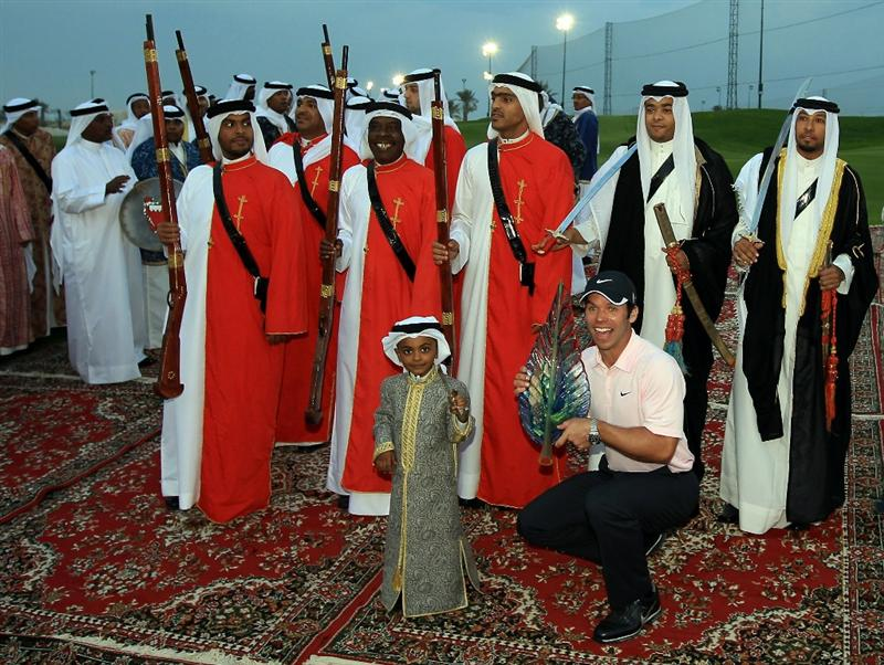 BAHRAIN, BAHRAIN - JANUARY 30:  Paul Casey of England holds the trophy as a group of local tribal dancers perform after the final round of the 2011 Volvo Champions held at the Royal Golf Club on January 30, 2011 in Bahrain, Bahrain.  (Photo by David Cannon/Getty Images)