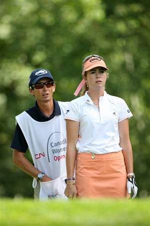 CALGARY, AB - SEPTEMBER 04 : Paula Creamer of the United States and her caddie Colin Cann line up her tee shot on the eighth hole during the second round of the Canadian Women's Open at Priddis Greens Golf & Country Club on September 4, 2009 in Calgary, Alberta, Canada. (Photo by Hunter Martin/Getty Images)