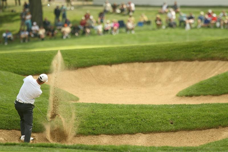 LEMONT, IL - SEPTEMBER 09:  Ryan Palmer hits a shot out of the bunker on the 18th hole during the first round of the BMW Championship at Cog Hill Golf & Country Club on September 9, 2010 in Lemont, Illinois.  (Photo by Scott Halleran/Getty Images)
