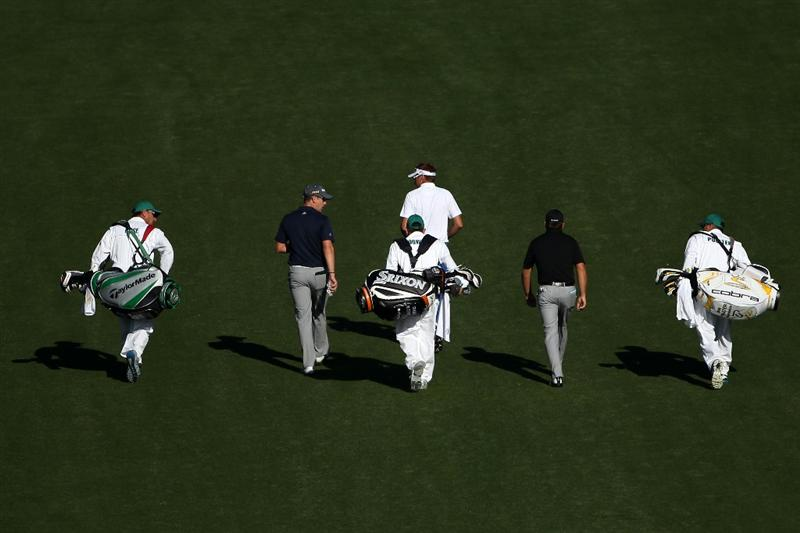 AUGUSTA, GA - APRIL 04:  Ian Poulter (C) of England, Graeme McDowell (R) of Northern Ireland and Justin Rose (L) walk with their caddies during a practice round prior to the 2011 Masters Tournament at Augusta National Golf Club on April 4, 2011 in Augusta, Georgia.  (Photo by Andrew Redington/Getty Images)