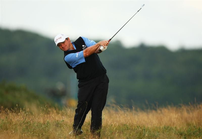 TURNBERRY, SCOTLAND - JULY 16:  Paul Lawrie of Scotland hits out of the rough on the 14th hole during round one of the 138th Open Championship on the Ailsa Course, Turnberry Golf Club on July 16, 2009 in Turnberry, Scotland.  (Photo by Richard Heathcote/Getty Images)